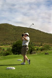 Golfer on the tee box Royalty Free Stock Photography