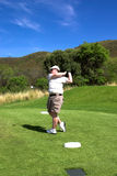 Golfer on the tee box. Stock Image