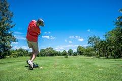 Golfer tee off Stock Photos