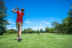 Golfer tee off Royalty Free Stock Photography