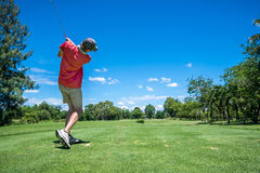 Golfer tee off Stock Photography