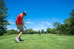 Golfer tee off Stock Images