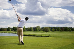 Golfer teeing off Royalty Free Stock Image