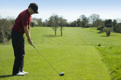 Golfer teeing off. From tee box stock images