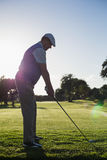 Golfer teeing off for the day Stock Photos