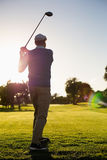 Golfer teeing off for the day Royalty Free Stock Images