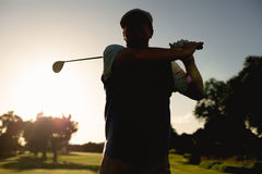 Golfer teeing off for the day Stock Images