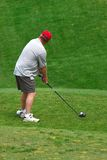 Golfer teeing off at golf. Golfer on the green at the golf course Stock Images