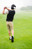 Golfer teeing off Royalty Free Stock Photos