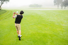 Golfer teeing off. At the golf course Stock Image