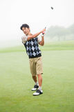 Golfer teeing off. The golf course Stock Images