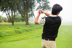 Golfer teeing off Stock Photography