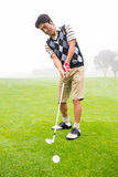Golfer teeing off. At the golf course stock photography