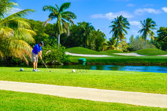 Golfer Teeing Off Stock Image