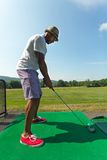 Golfer Teeing Up at the Driving Range Royalty Free Stock Image