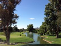 Golfer on the 18th hole of a golf course in Arizona royalty free stock photo
