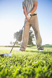 Golfer about to hit golf ball Royalty Free Stock Images