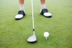 Golfer about to tee off Stock Photo