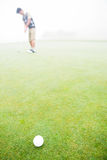 Golfer about to tee off Royalty Free Stock Photo