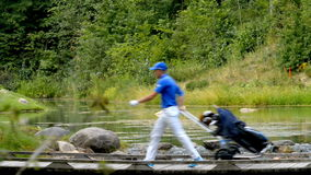 Golfer traverses the river Royalty Free Stock Photography