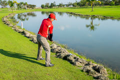 Golfer try to play the ball on cut grass Royalty Free Stock Images