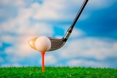 Golfer use golf club hitting golf ball on tee off zone stock photo