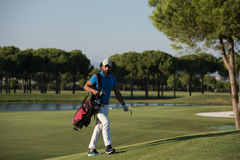 Golfer  walking and carrying bag Royalty Free Stock Photos