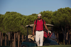 Golfer  walking and carrying golf  bag Stock Images