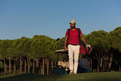 Golfer  walking and carrying golf  bag Stock Photography