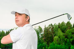 Golfer in white clothes is playing golf. Cute golfer in white clothes is playing golf Stock Photography