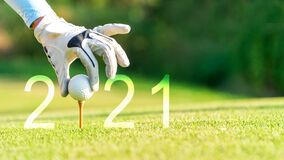 Free Golfer Woman Putting Golf Ball For Happy New Year 2021 On The Green Golf For New Healthy. Royalty Free Stock Photos - 200978068