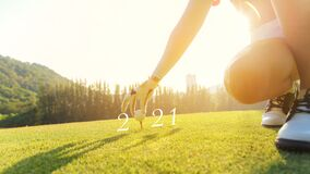 Golfer woman putting golf ball for Happy New Year 2021