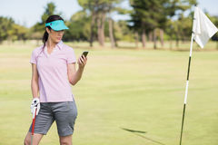 Golfer woman using phone Stock Photos