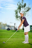 Golfer woman. Young golfer woman on golf course Royalty Free Stock Photos
