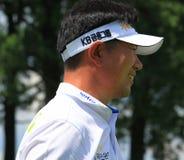 Golfer YE Yang. Y.E. Yang (Yang Yong-eun) watches his drive miss the fairway Royalty Free Stock Photos