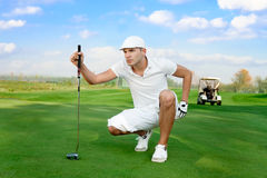 Golfer. Young handsome golfer on  a golf course Stock Photos