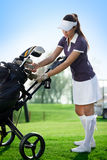 Golfer  young woman. With golf bag Royalty Free Stock Photos