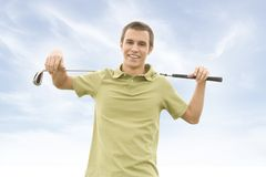 Golfers. People against blue sky with golf clubs Stock Photo