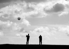 Golfers. Two golfers with flying golf ball Royalty Free Stock Photo