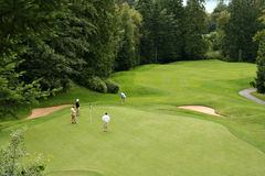 Golfers. On the putting green Royalty Free Stock Image