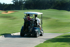 Golfers on cart. Royalty Free Stock Images