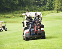 Golfers in Carts. Driving to their balls Stock Photos