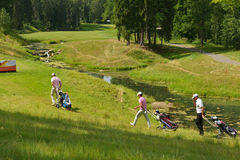 Golfers on the course Stock Images