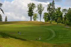 Golfers on the course Royalty Free Stock Photography