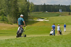 Golfers on the course Stock Photography