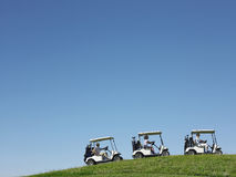 Golfers Driving Carts Stock Image