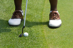 Golfers feet. Feet of a golfer playing a putt from just off the green Stock Images