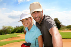 Golfers on golf course Royalty Free Stock Photo