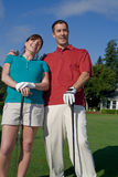 Golfers Laugh at Camera - Vertictal Stock Photos