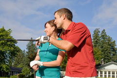 Golfers Look into Distance - Horizontal Stock Photo